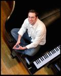 Free performance by pianist Ethan Uslan at Plaza Midwood Library